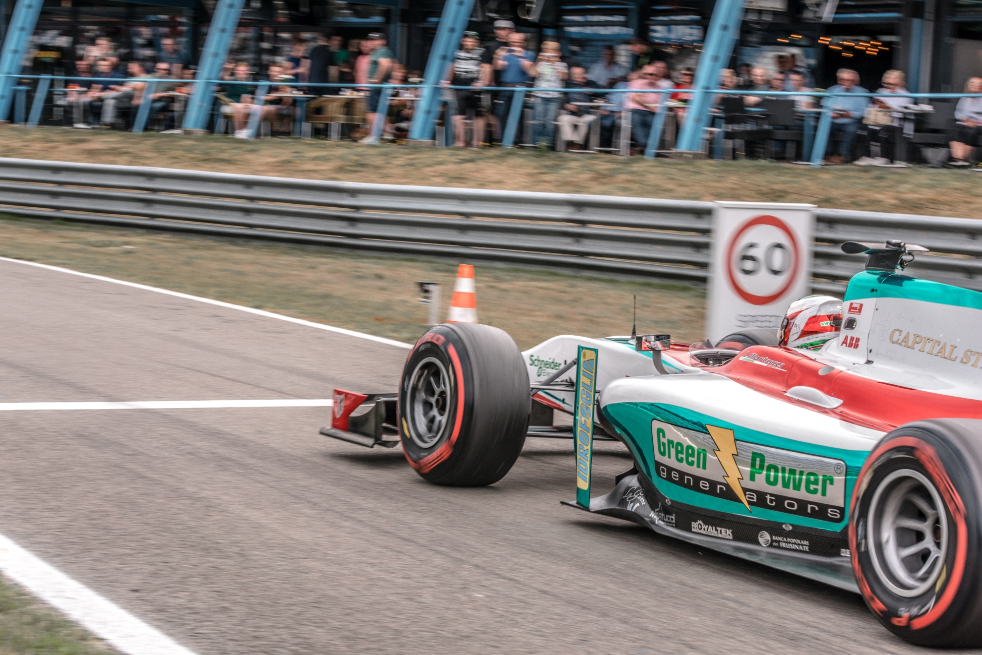 A GP2 car drives into the pit lane in Assen
