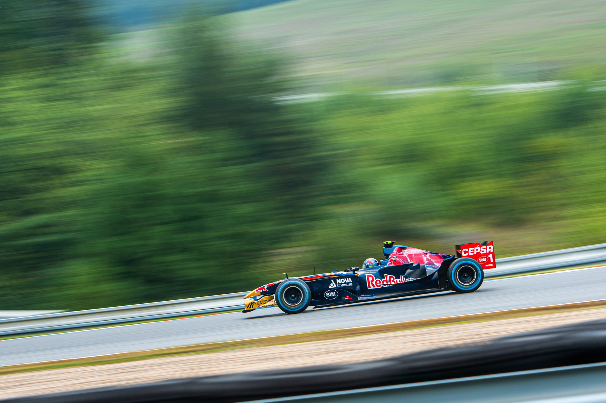 Ingo Gerstl flys by in his Toro Rosso STR 1 in 2019 Brno Qualifying