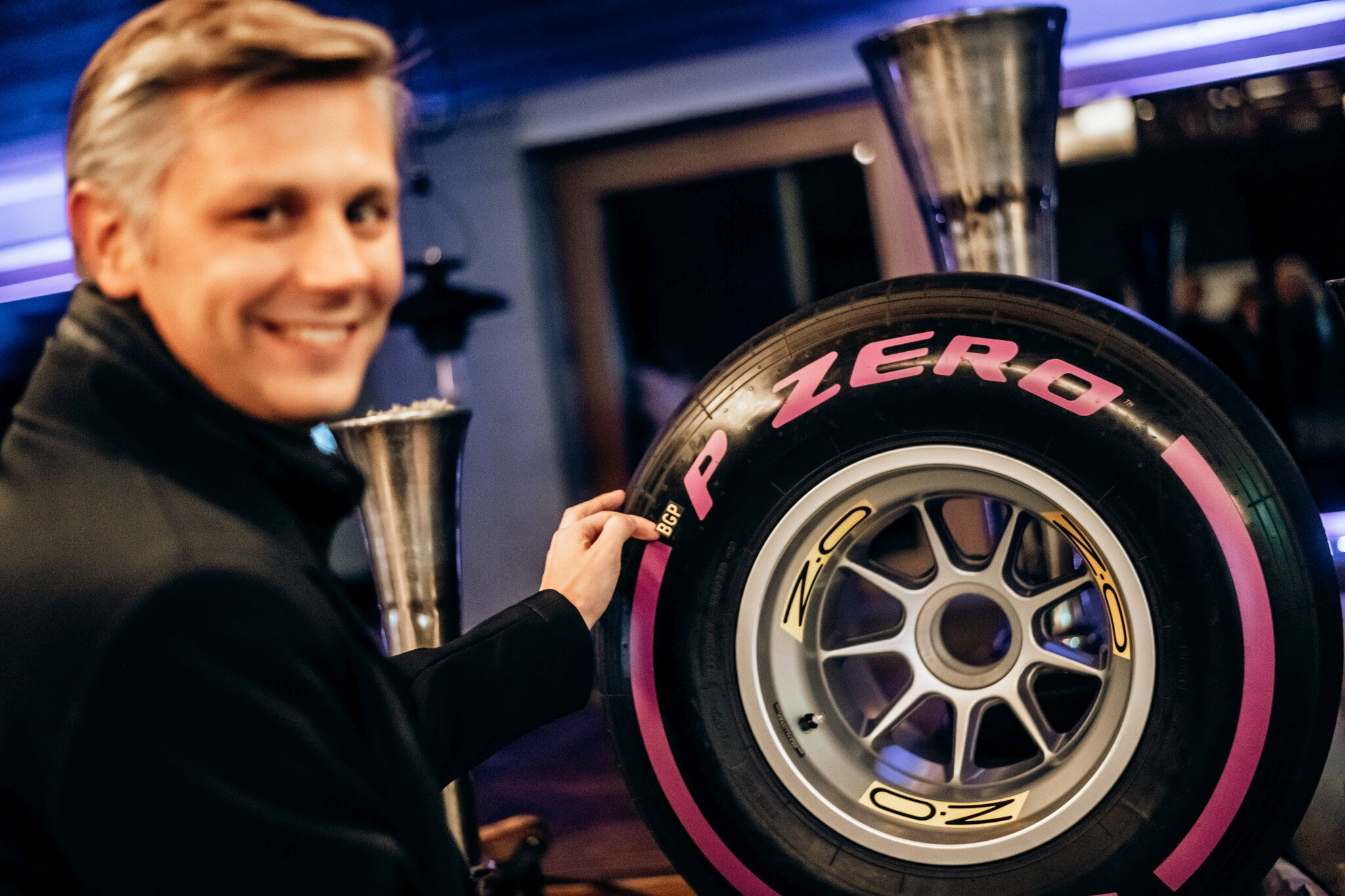 Matteo Braga from Pirelli with the 2020 BOSS GP tyre - Credit Michael Jurtin
